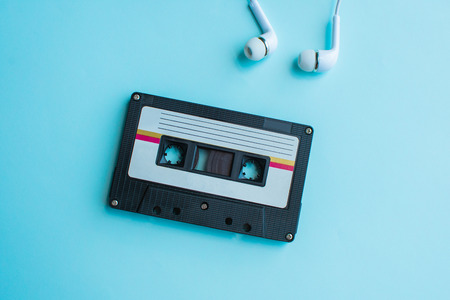 retro of tape cassette on blue and pink background. soft focus.