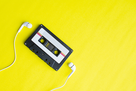 retro of tape cassette on yellow background. soft focus. Imagens