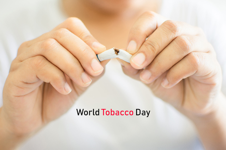 human hand holding cigarette and World No Tobacco Day concept. soft focus.