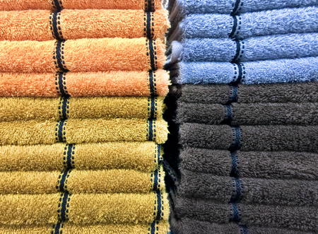 red carpet background: Stacked Orange, Blue and Gray Fluffy Towels