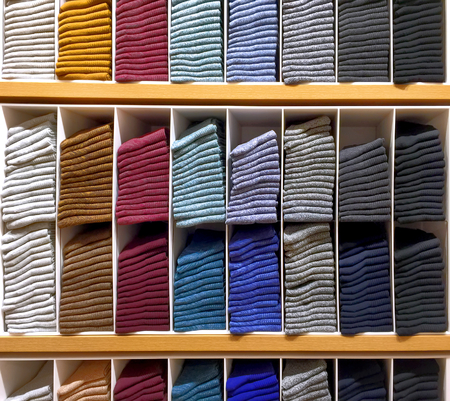 Folded Colorful Soft Socks on Shelf Stock Photo