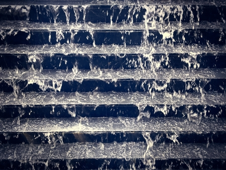 Cooling Water Flowing Down Black Stair Steps Archivio Fotografico