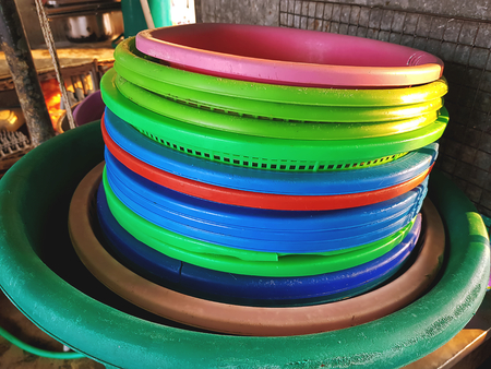 Old Stacked Colorful Plastic Tubs at the Kitchen Banco de Imagens