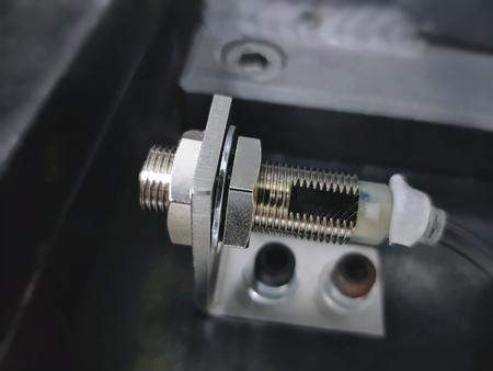 Shiny Proximity Sensor with Bracket to Detect Metal Parts Banco de Imagens