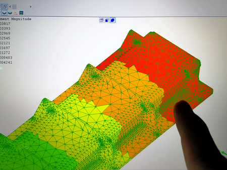 Finger Pointing at Computer Screen with Finite Element Analysis Result