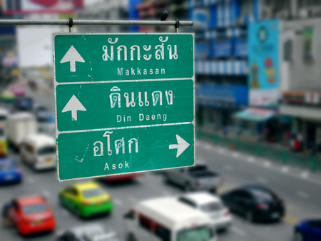 Street Directional Labels with Thai and English Texts and Arrows to Other Places in Bangkok
