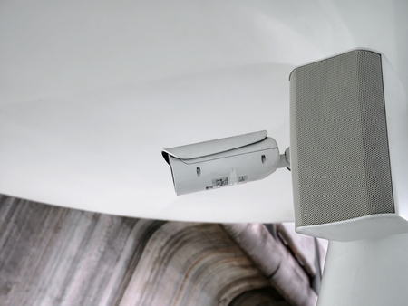 Low Angle View of White Security Surveillance Camera with Audio Speaker 版權商用圖片
