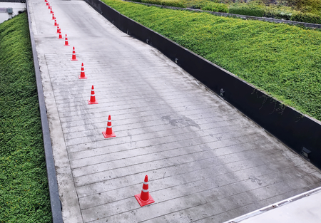 High Angle View of Group of Orange Traffic Cones Along the Road