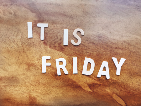 It is Friday Texts on Wooden Background Archivio Fotografico