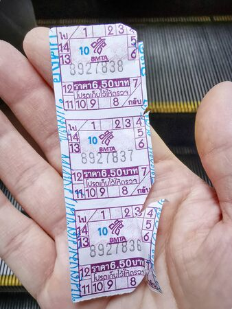 Pathumwan, Bangkok  Thailand - April 3, 2019: Hand Holding Public Bus Fare Tickets