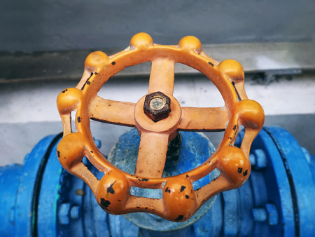 Close-up Rusty Orange Wheel for Open and Close Ball Valve with Selective Focus