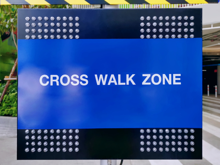 Blue Traffic Panel with Light Bulbs and Cross Walk Zone Warning Texts