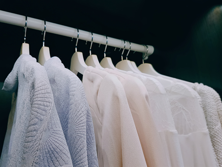 Group of Clothes for Women Hanging Inside the Wardrobe Stock Photo