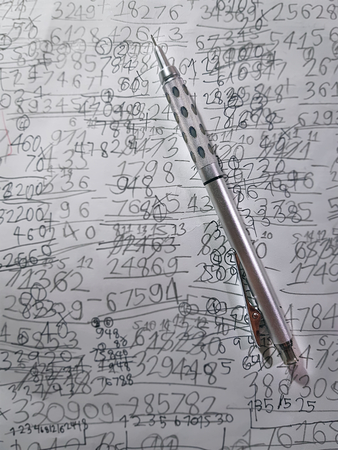 High Angle View of Mechanical Pencil on Hand-Written Math Calculation Paper Sheet Background Фото со стока