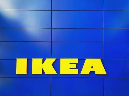 Bangkaew, Samut Prakan  Thailand - June 15, 2019: Yellow Logo of IKEA Furniture Store on Blue Tiled Wall