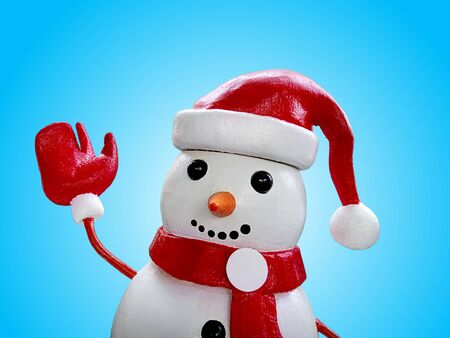 Close-up Snowman Doll Isolated on Blue Background 스톡 콘텐츠