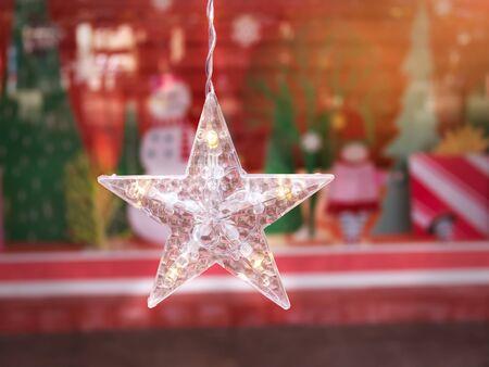 Close-up Hanging Decorative Illuminated Star Against Blurred Background