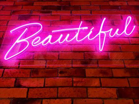 Pink Illuminated Glowing Beautiful Text on Brick Wall