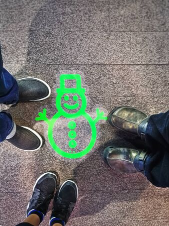 High Angle View of Green Snowman Doodle on Floor 스톡 콘텐츠