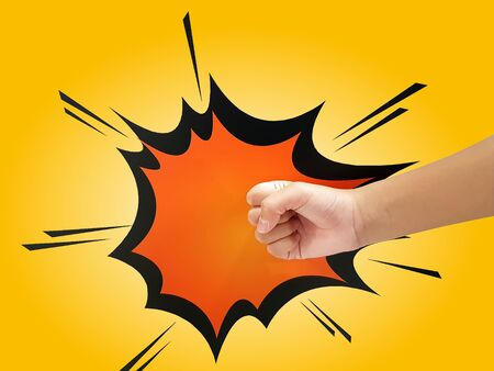 Close-up Fist with Cartoon Punch Effect Isolated on Yellow Background