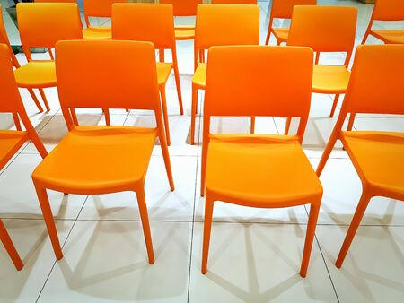 Group of Empty Orange Plastic at Conference 스톡 콘텐츠