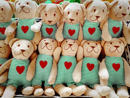 Group of Fluffy Stuffed Bear Toys Wearing Clothes with Red Heart Symbols