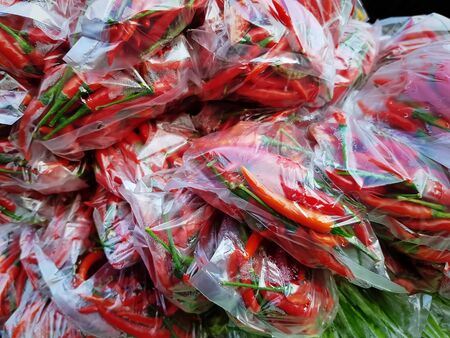 Full Frame Background of Red Hot Chilies in Plastic Bags