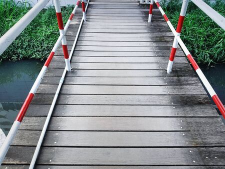 High Angle View of Wooden Plank Walkway Over Small Canal 스톡 콘텐츠