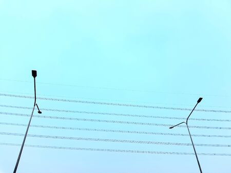 Low Angle View of Street Lighting Posts Against Clear Blue Sky