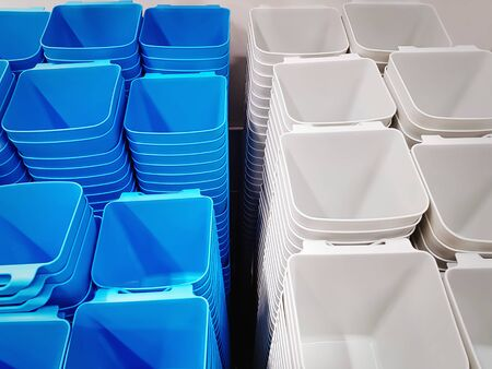 Group of Stacked White and Blue Plastic Containers for Sale