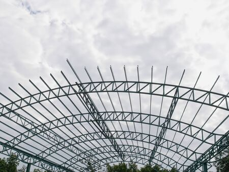 Low Angle View of Unfinished Warehouse Construction Against Cloudy Sky