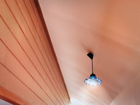 Low Angle View of Illuminated Lamp Hanging Under Ceiling