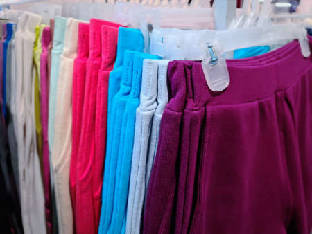 Soft Colorful Pants Hanging on the Rack For Sale at Clothing Store
