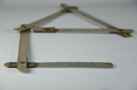 collapsible: Old metal collapsible meter with figures and a scale