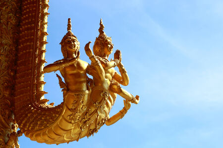 golden  religion  sculpture in nan province, thailand photo