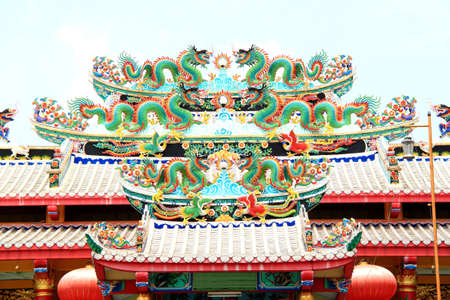 Glance of the Dragon on Thai Roof of the Chinese dragon photo