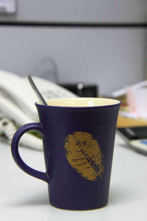 Office equipment in a cup of coffee photo