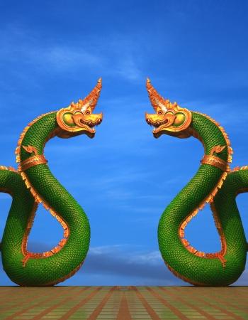 twain: twain Naga statue of thailand with nice sky Stock Photo