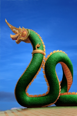 naga china: Naga statue of thailand with nice sky Stock Photo