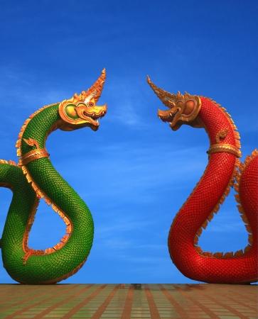 naga china: twain Naga statue of thailand with nice sky Stock Photo