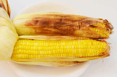 husks: Grilled  corn on the cob Stock Photo