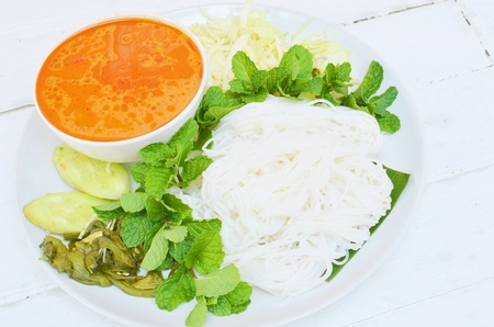 Rice noodles in fish curry sauce with vegetables