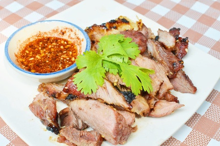 Rotast Pork and spicy sauce Stock Photo