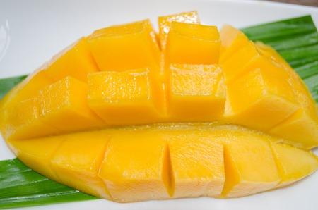 Ripe mango arranged in a white dish. Stock Photo