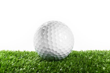 Golf ball on green lawn
