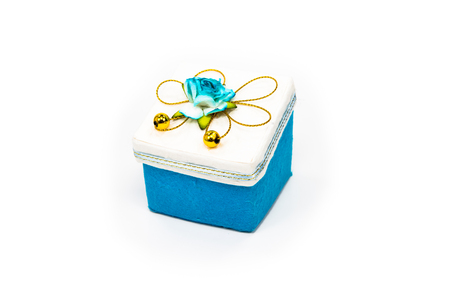 Blue gift box placed on white floor. Stok Fotoğraf