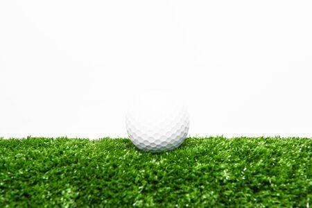 Green golf ball on green lawn