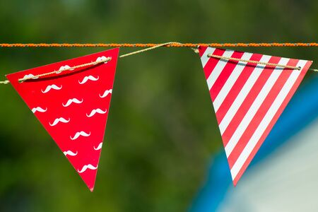 The flag is a symbol of our tent to bundle with wind direction. Stock Photo