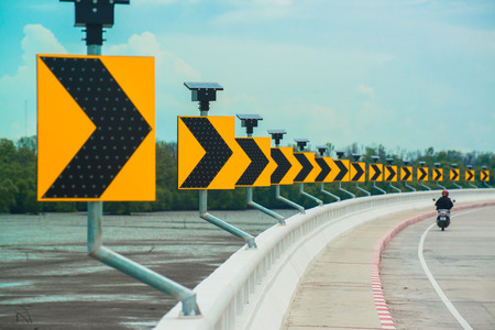 Yellow rifle symbolizes the curve of the road in Thailand.