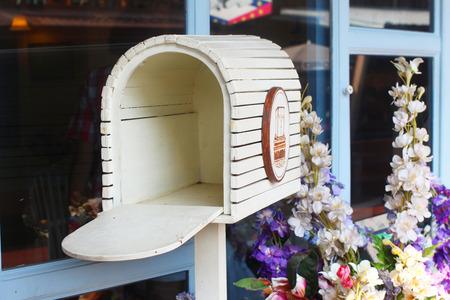 Vintage Wooden Mailbox In Garden